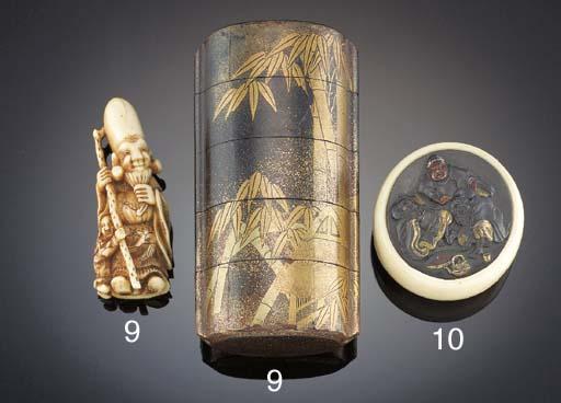 A Japanese ivory inset kagamib