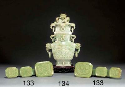 A pair of creamy celadon jade