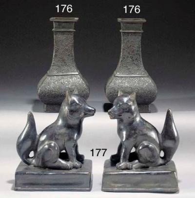 A pair of Japanese bronze Fush