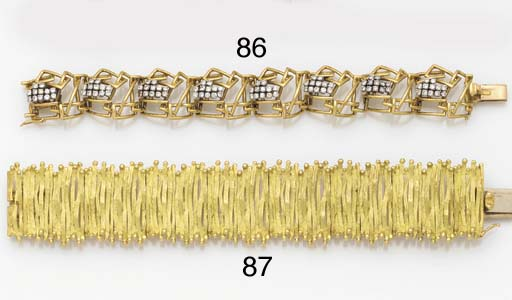 AN 18CT GOLD BRACELET BY ALAN
