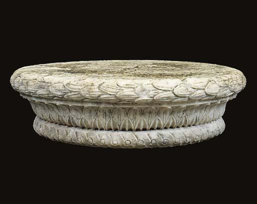 A sculpted white marble capita