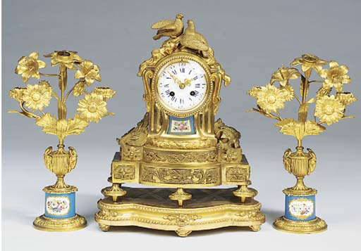 A French gilt metal and Sevres