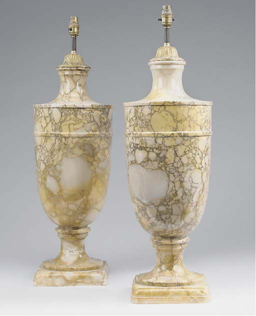 A pair of variegated marble ta