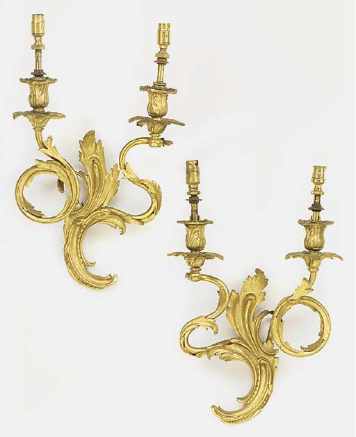 A set of three gilt brass  twi