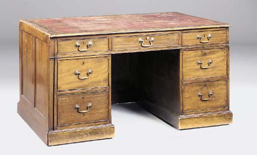 A mahogany kneehole desk, late