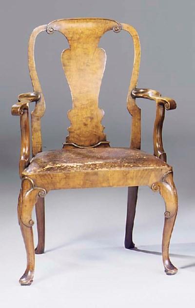 A walnut open armchair, early
