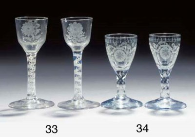 A pair of engraved faceted-ste