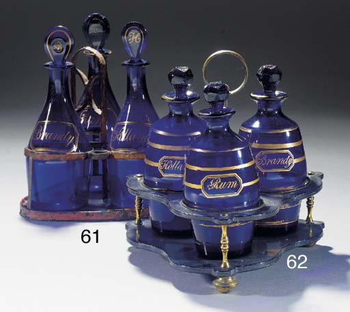 Three blue-glass decanters, st