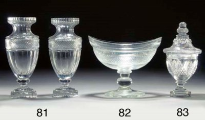A cut-glass urn and cover