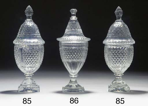 A pair of cut-glass urns and c