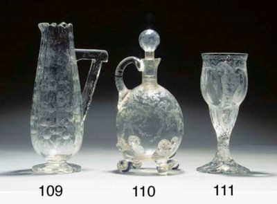 An engraved decanter and stopp