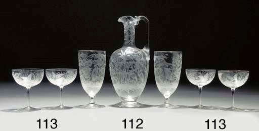 An engraved ewer and two goble
