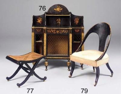 A Regency ebonized easy chair