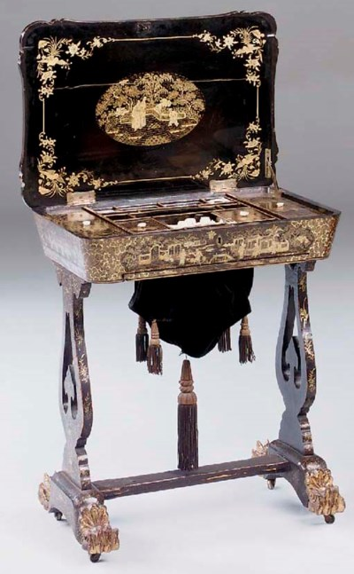 A black and gilt laquered chin