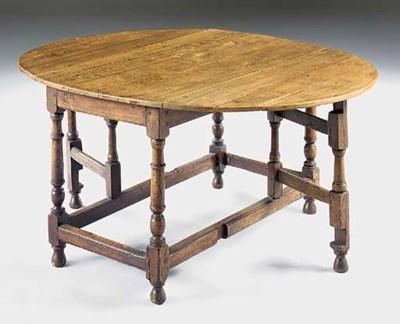 An oval oak gateleg dining tab