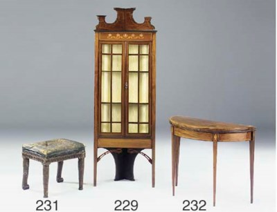 A mahogany and inlaid standing