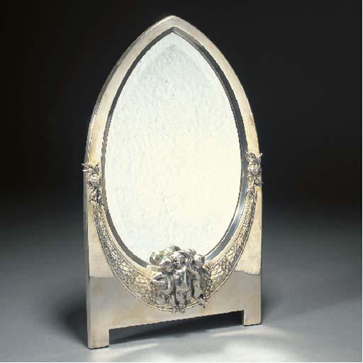 A WMF silvered metal toilet mirror