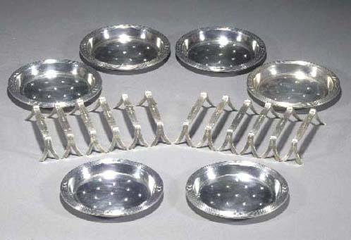 A set of twelve WMF silvered metal knife rests
