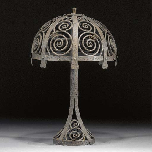 A European Arts and Crafts wrought iron table lamp