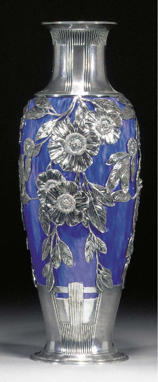 An A.O.G. 'Orivit' mottled glass vase with silvered metal mount