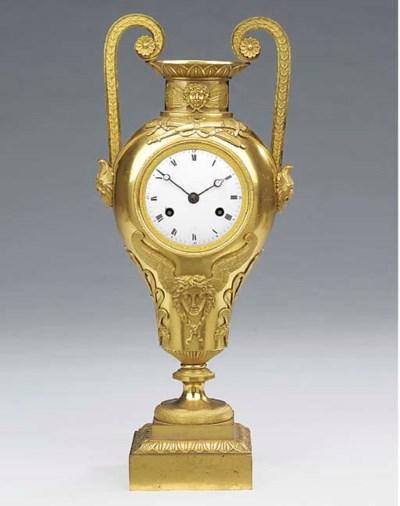 An Empire ormolu striking urn
