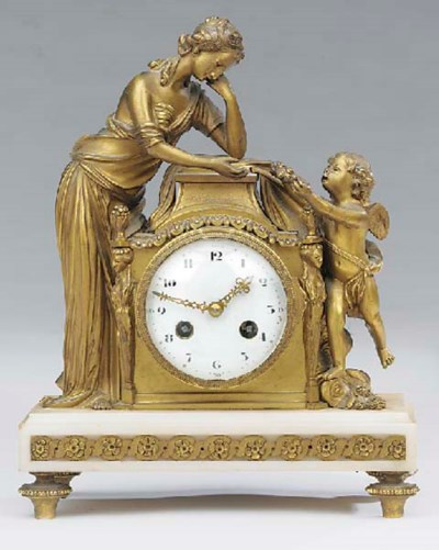 A Louis XVI style gilt-bronze