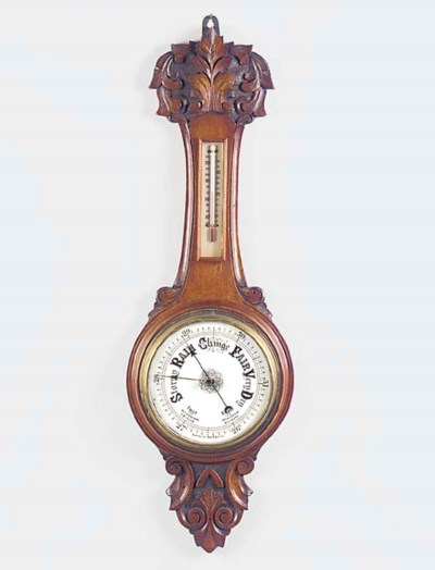 A Victorian carved oak aneroid