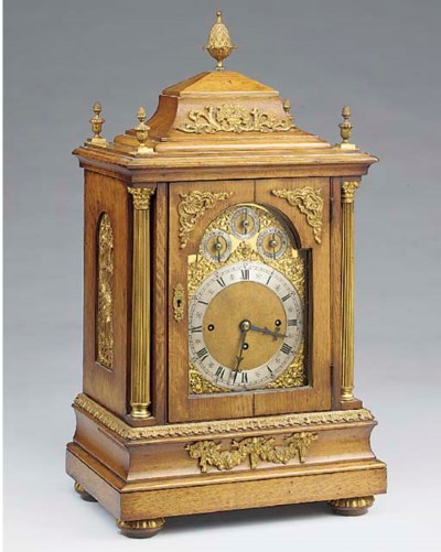 A late Victorian oak and gilt-