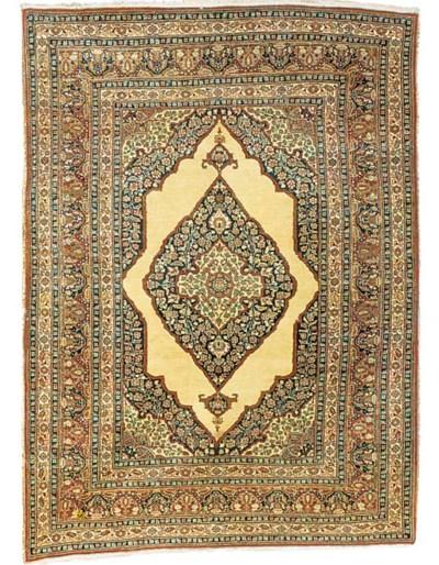 An antique Tabriz rug, North-W