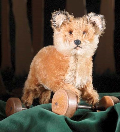 A Steiff fox on wheels