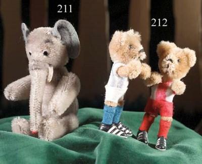 A Schuco miniature footballer