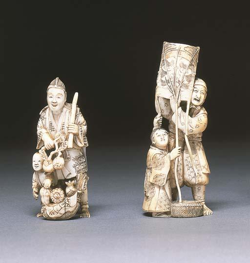 An ivory okimono of a father a