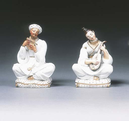 A pair of Paris figural flasks