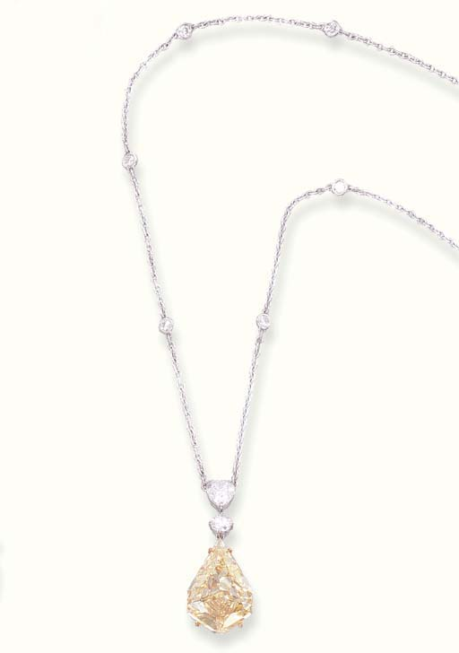 A YELLOW DIAMOND PENDENT NECKL