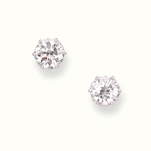 A PAIR OF CIRCULAR-CUT DIAMOND