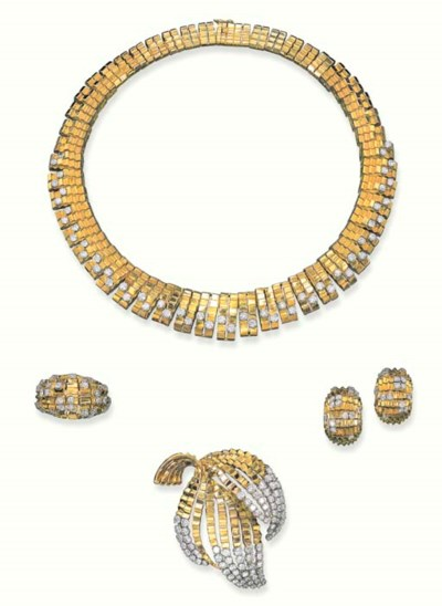 AN ELEGANT SUITE OF GOLD AND D