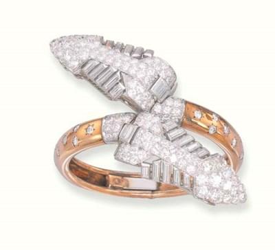AN ART DECO DIAMOND BANGLE, BY