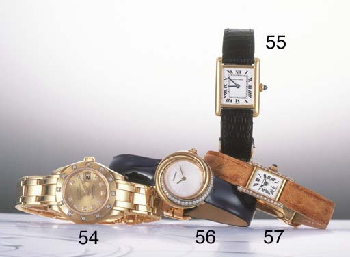 CARTIER. A LADY'S 18K YELLOW G