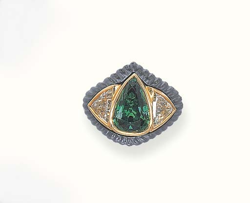 AN EMERALD, DIAMOND AND HEMATI