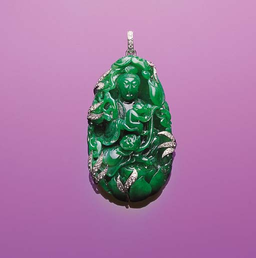 A WELL CARVED JADEITE GUANYIN AND DIAMOND PENDANT