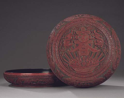 A CARVED POLYCHROME LACQUER 'S