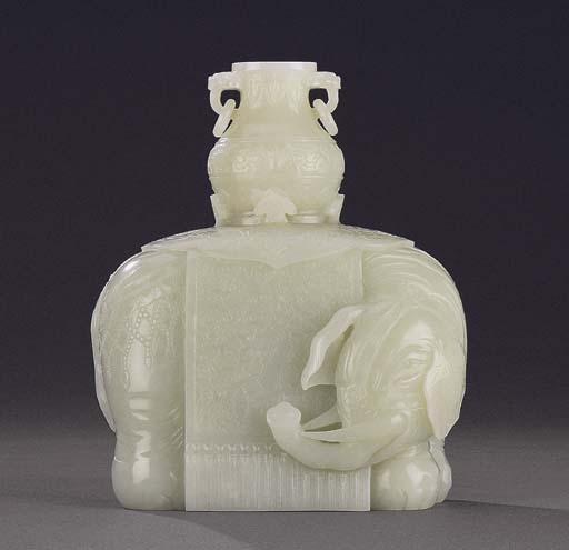 A FINELY CARVED WHITE JADE ELE