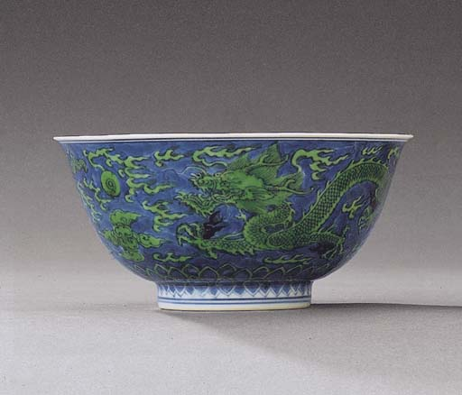 A FINE GREEN-ENAMELLED AND UND