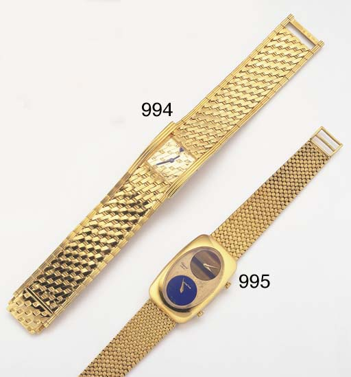 CHOPARD. AN 18K GOLD DUAL TIME
