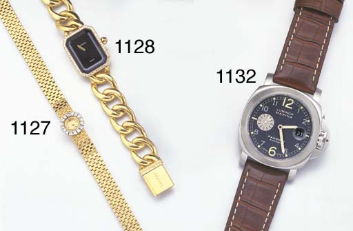 SWISS. A LADY'S 18K GOLD AND D