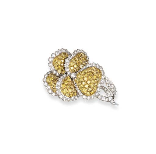 A YELLOW DIAMOND AND DIAMOND F