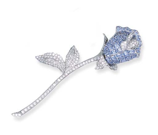 A SAPPHIRE AND DIAMOND ROSE CL
