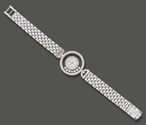 A LADY'S 18K WHITE GOLD AND DI