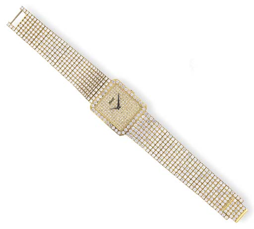 AN 18K GOLD AND DIAMOND WRISTW