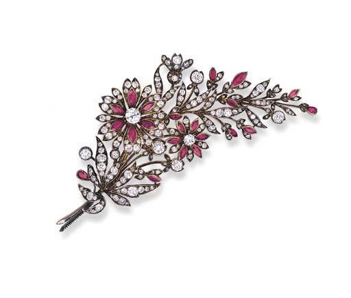 A DIAMOND AND RUBY FLOWER BROO